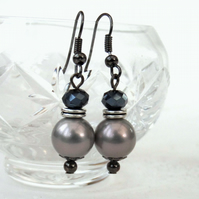Silver shell pearl and jet crystal earrings on gunmetal wires