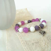 Pink and purple stretchy bracelet, with heart charm