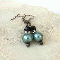 Green shell and black crystal earrings