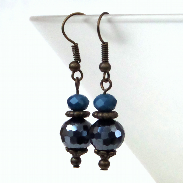 Vintage style bronze earrings with jet blue crystals