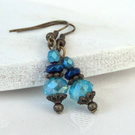 Vintage style bronze earrings with blue crystals