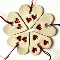 Handmade ceramic heart decorations
