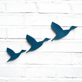 Flying ducks wall art set of three in teal blue ceramic