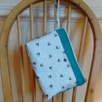 Bright green bird and tiny spots print make-up bag with zip fastening
