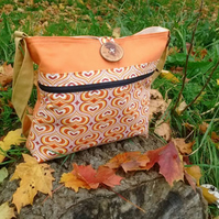 Large crossbody bag in warm heart print cotton and orange backing