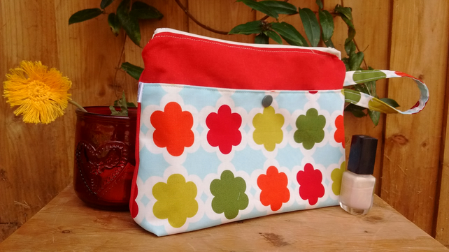 Bright coloured floral print and red make up bag with zip closure and pocket