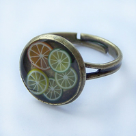 Antiqued brass ring with citrus fruit, adjustable