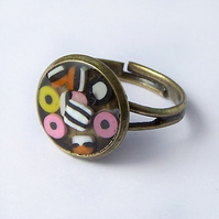 Antiqued Brass ring with liquorice allsorts, adjustable