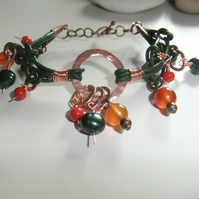 Green Leather 'Copper Rings' Bracelet with Carnelian, Coral and Pearls.