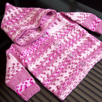 Girls Hooded Cardigan Raspberry Ripple jacquard pattern, age 6 to 9 Month