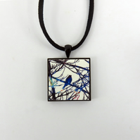 Bird on a branch wooden tile pendant