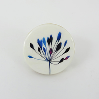 Round, wooden, delicate blue flower brooch
