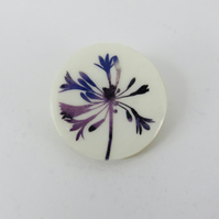Round, wooden, delicate blue and purple flower brooch