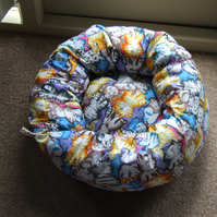 Lovely soft bed for cat or small dog printed with cartoon cats and dogs.
