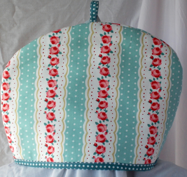 Tea cosy with printed roses.