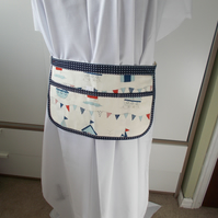 Hand made apron with beachhuts.