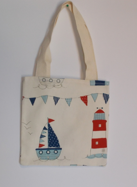 Mini tote bag printed with beach huts and lighthouses