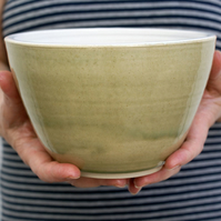 One high sided stoneware pottery bowl - glazed in olive green and white