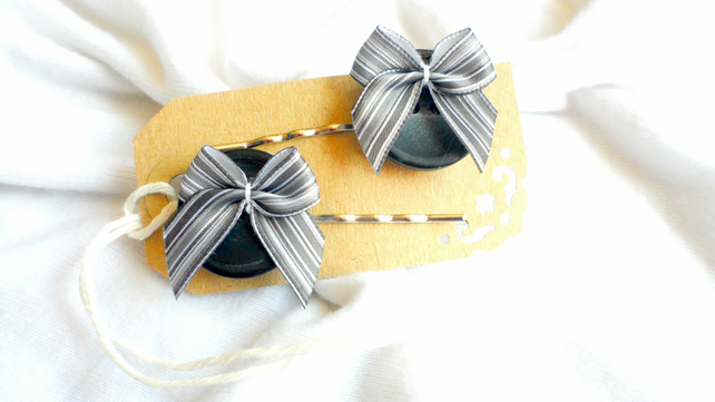 A pair of Bow Button Hair Slides