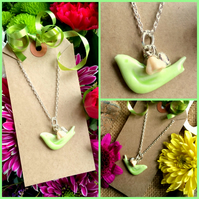 Pastel Green Ceramic Bird Pendant with Heart and small Glass cream ivory flower