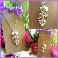 "Hearts and flowers cluster on 18"" chain"