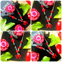 SALE Kitsch fun asymmetric Red and Black Bow necklace - Buttons, Beads