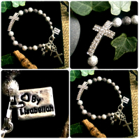 Sideways cross bracelet with silver and gunmetal stardust beads and cross charms