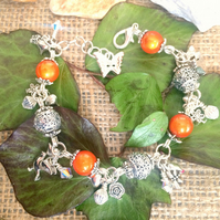Orange and Silver Beaded Charm bracelet with Swarovski crystals
