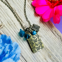 SALE Beautiful bronze and teal butterfly necklace