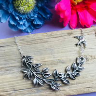 Beautiful bird and branch necklace with sparkly cut glass bead