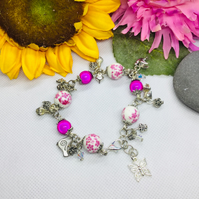 Pink and white bracelet with charms