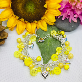 Yellow eye catching button and bead bracelet