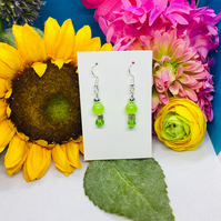 Offer Green and silver colour earrings