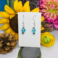 Offer Turquoise and silver colour drop earrings