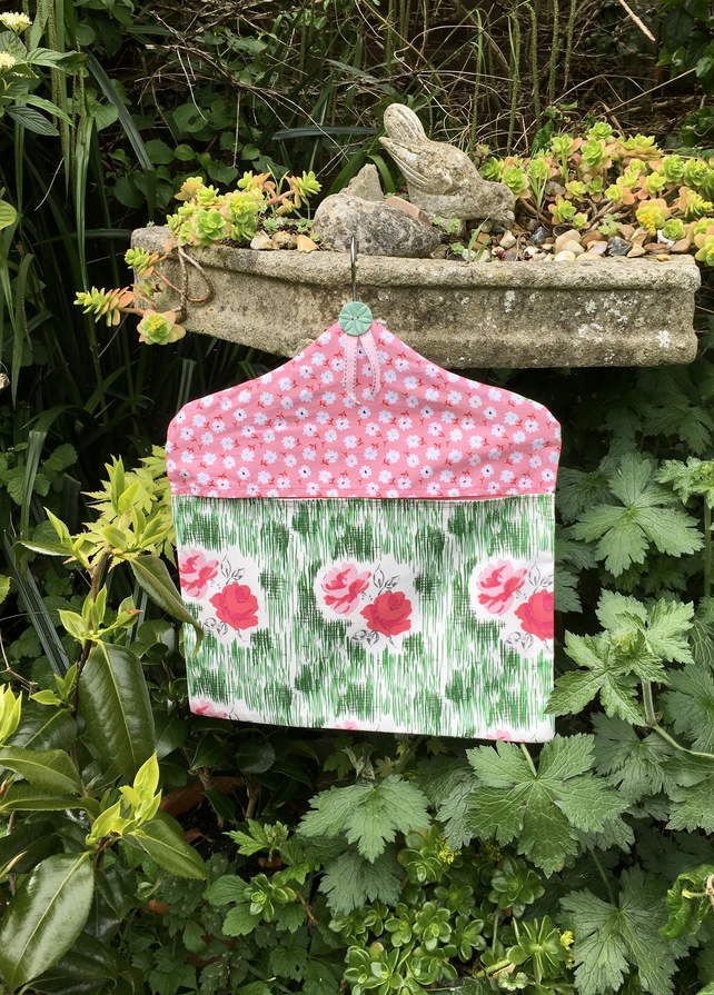 Peg bag in a retro theme pink and green rose design. Free UK P & P. Wash day bag