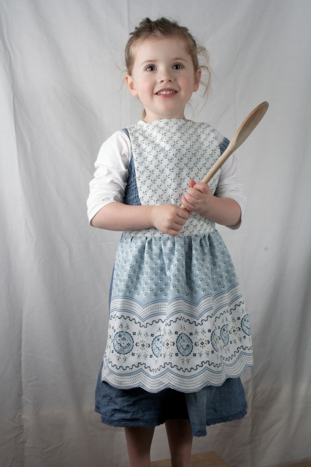Child's Pinafore Apron – pale blue and white flower pattern with a scalloped hem