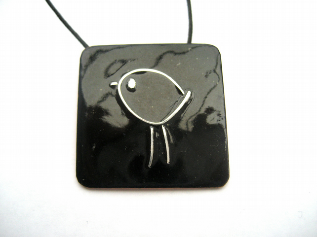 Silver bird on black enamelled pendant