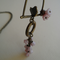30 inch Brass Necklace Bird on a Perch with Cascading pink Czech flowers
