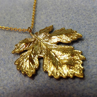 Maple Leaf Charm Necklace in 14K Matt Gold Plate (20)