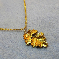 Frilly Ash Leaf Charm Necklace in Gold Plate (27np)