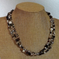 Black, White with tones of grey and brown Colour Three Strand Beaded Necklace
