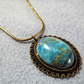 Blue Sea Sediment Jasper Cabochon Pendant. Bronze tone necklace (Style NP)