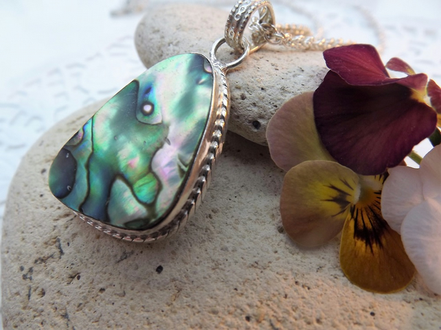 Abalone pendant in irregular shaped silver plate cabochon setting