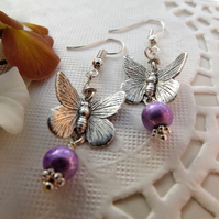 Butterfly charm and purple beaded earrings.  Drop earrings. Silver plated.