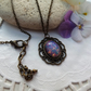 Faux Glass Opal Cabochon Necklace in a bronze tone Lacey Cabochon Setting (style