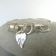 Silver Bangle with Leaf Charm and Spinner Rings
