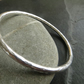 Heavy sterling silver bangle with lightly textured finish