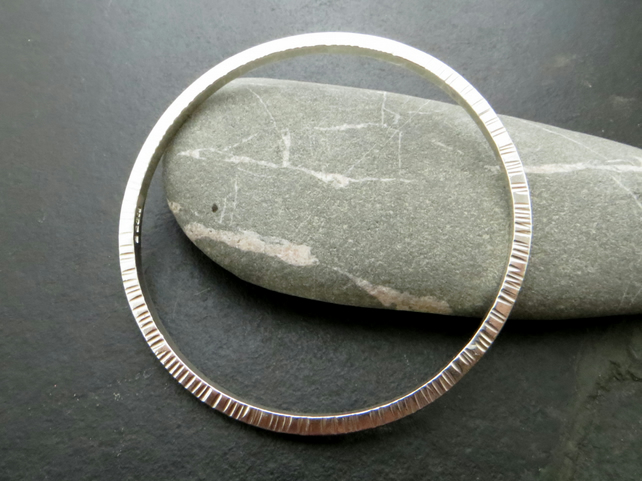 Contemporary square wire bangle with line texture