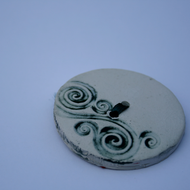 Ceramic button.