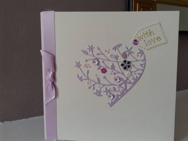 Delicate heart with love card